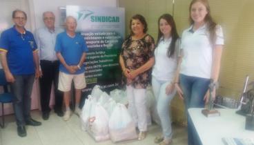 Doação de sacolas de alimentos para Lions Clube Industrial